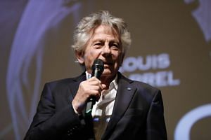 Roman Polanski speaks on stage after a preview of his last movie in Paris on Nov 4, 2019.