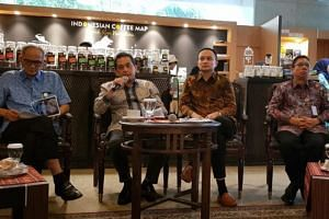 Indonesia's Trade Minister Agus Suparmanto (second from left) and on his right Deputy Trade Minister Jerry Sambuaga during a media briefing on Indonesia's plans to boost its exports to revive economic growth.