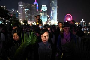 People attending a prayer rally in Hong Kong's Tamar Park on Nov, 9, 2019, in memory of 22-year-old university student Chow Tsz-lok who died on Nov 8.