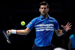 Serbia's Novak Djokovic (above) in action during his group stage match against Italy's Matteo Berrettini on Nov 10, 2019.