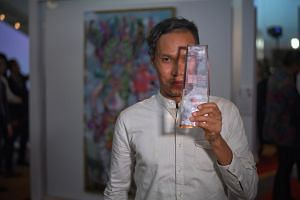 Street artist Anagard clinched the UOB Southeast Asian Painting of the Year award for Welcome Perdamaian, Goodbye Kedengkian (Welcome Peace, Goodbye Hostility), inspired by a house of prayer in Central Java.
