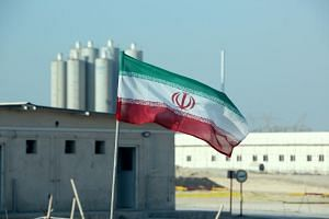 An Iranian flag flies in Iran's Bushehr nuclear power plant, during an official ceremony to kick-start works on a second reactor at the facility on Nov 10, 2019.