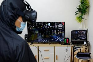 """Liberate Hong Kong"" allows gamers to don a VR headset and dodge tear gas and rubber bullets during a nighttime clash in the district of Mong Kok."
