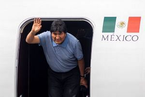Morales arrives at an airport in Mexico after he was granted a political asylum.
