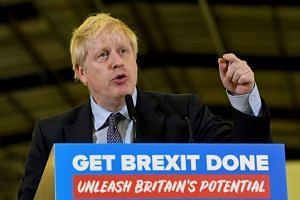 Johnson delivers a speech during an election campaign visit to the London Electric Vehicle Company in Coventry, England.