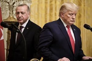 Erdogan (left) arrives for a press conference with Trump at the White House on Nov 13, 2019.