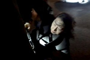 Hong Kong Justice Secretary Teresa Cheng fell while being surrounded by a crowd of jeering pro-democracy protesters in London on Nov 14, 2019.