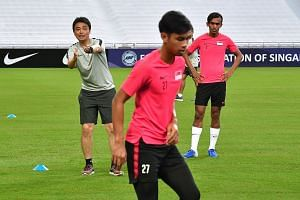 Singapore coach Tatsuma Yoshida and Shakir Hamzah (right) at a national team training session. The left-back was dropped for yesterday's friendly against Qatar and next Tuesday's away World Cup qualifier against Yemen, after he missed training last w