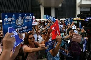 Supporters of the Hong Kong Police Force participate in a pro-law enforcement rally outside the Legislative Council building in Hong Kong, on Nov 16, 2019.