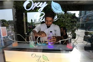 At Oxy Pure, customers can inhale oxygen infused with essential oils such as lavender and lemongrass through tubes strapped to their noses.