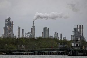 A refinery near the Corpus Christi Ship Channel is pictured in Corpus Christi, Texas. In that state, where oil and gas products comprise the largest export to China, sales fell 39 per cent.
