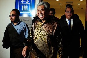 Umno president Ahmad Zahid Hamidi (centre) is on trial at the Malaysian High Court for 47 charges involving transactions totalling RM117.25 million involving his charity foundation.