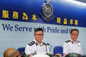 Deputy Commissioner of Police Tang Ping-keung (left), also known as Chris Tang, and Commissioner of Police Lo Wai-chung attend a news conference in Hong Kong on June 13, 2019.