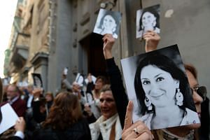 In a photo taken on April 16, 2018, people leave the church of St Francis after a mass in memory of murdered journalist Daphne Caruana Galizia on the sixth month anniversary of her death in Valletta, Malta.