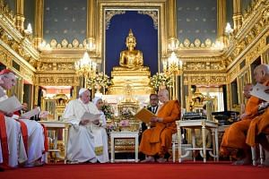 Pope Francis meets Thailand's Supreme Buddhist Patriarch Somdej Phra Maha Muneewong at the Wat Ratchabophit temple in Bangkok on Nov 21, 2019.