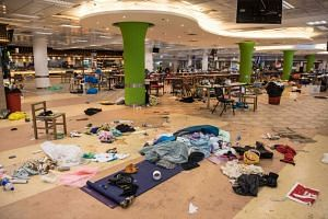 Belongings leftover from protesters who barricaded themselves on campus are seen in a canteen at the Hong Kong Polytechnic University in Hong Kong on Nov 22, 2019.