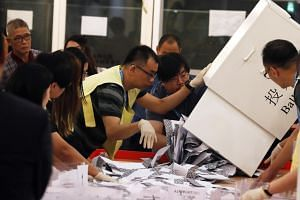 Officials counting ballots at a polling station in Hong Kong during the local district elections on Nov 24, 2019.