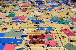 Scattered clothes, protective gear and other objects are seen in a basketball hall in the Hong Kong Polytechnic University, on Nov 26, 2019, over a week after police surrounded the building while protesters were still barricaded inside.