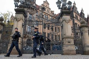 Police officers leaving the Residenzschloss Royal Palace that houses the historic Green Vault (Gruenes Gewoelbe) in Dresden on Nov 27, 2019.