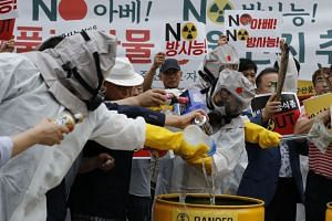 South Koreans throwing away Japanese products during a rally calling for the boycott of Japanese products on Aug 28, 2019. Exports of Japanese beer to South Korea fell to almost zero in October.