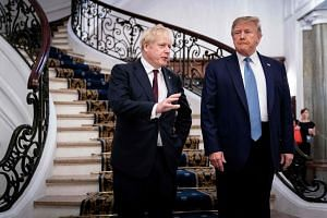 Britain's Prime Minister Boris Johnson and US President Donald Trump speak to media before an event at the Group of 7 Summit in France on Aug 25, 2019.