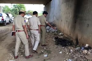 Indian police officers inspect the site where they found the burned body of a veterinarian on the outskirts of Hyderabad, India, on Nov 29, 2019.