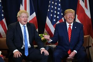 US President Donald Trump and British Prime Minister Boris Johnson meeting at UN Headquarters in New York on Sept 24, 2019.