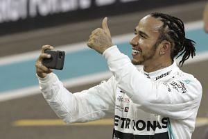 Lewis Hamilton celebrates after taking pole position for the Abu Dhabi Grand Prix.