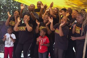 The Soweto Gospel Choir sing for a crowd attending a World Aids Day commemoration at Nkosi's Haven in Johannesburg, on Nov 30, 2019.