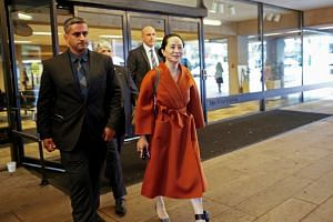 In a photo from Sept 23, 2019, Huawei Technologies Chief Financial Officer Meng Wanzhou leaves for a lunch break during a hearing at the British Columbia Supreme Court in Vancouver, Canada.