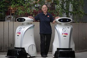 Sun City Maintenance cleaner Lily Goh, 75, has attended many courses, including workplace safety and the use of cleaning robots (above). ST PHOTO: JASON QUAH