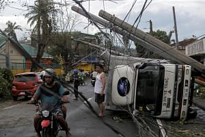 Residents are seen after Typhoon Kammuri hit Camalig town, Philippines, on Dec 3, 2019.