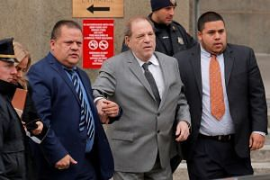 Weinstein (centre) leaves court after the hearing in New York.