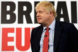 Johnson reacts as he launches a Conservative Party general election campaign poster.