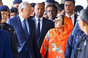 A photo taken on Oct 4, 2018, shows Malaysia's former prime minister Najib Razak and his wife Rosmah Mansor leaving the Kuala Lumpur Courts Complex, where they both appeared in separate courts.
