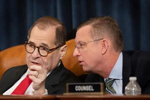 House Judiciary Chairman Jerry Nadler (L), speaks with Ranking Member Doug Collins (R), as Minority Counsel Stephen Castor and Majority Counsel Daniel Goldman testify during the House Judiciary Committee hearing as part of the impeachment inquiry int