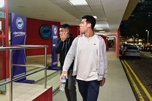 SEA Games players Zharfan Rohaizad (left) and Lionel Tan walk into the Football Association of Singapore premises in Jalan Besar Stadium on Dec 11, 2019.