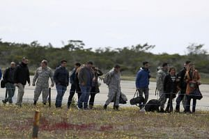 Relatives of passengers aboard the missing plane arrive at an airbase in Punta Arenas, Chile, Dec 11, 2019.
