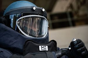 A police officer is seen wearing a bomb suit during a media tour of the Hong Kong Police Explosive Ordnance Disposal Bureau depot in Hong Kong on Dec 6, 2019.