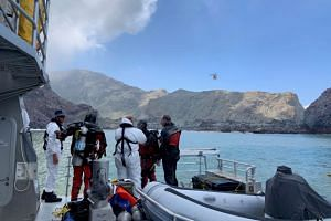 Members of a dive squad conduct a search during a recovery operation around White Island in New Zealand, on Dec 13, 2019.