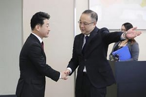 Mr Yoichi Iida (right), director-general at the Japanese trade ministry's trade control department, meets his South Korean counterpart Lee Ho-Hyeon in Tokyo on Dec 16, 2019.