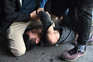 A man is detained by police during a protest held by pro-democracy activists in Hong Kong on Dec 18, 2019.