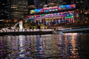 Light projections on the facade of The Fullerton Hotel during a media preview of the  Marina Bay Singapore Countdown 2020.