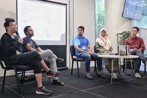 (From left) The Future of Migrant Writing in Singapore panel discussion with Head of Math Paper Press and Co-founder of Books Actually Kenny Leck, Migrant Worker Poetry Competition organiser Shivaji Das, migrant poets Bikas Nath and Yulia Endang, wi