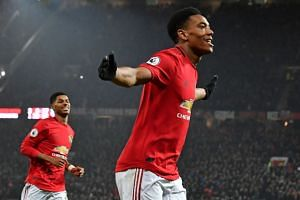 Martial celebrates after scoring his second goal, the team's fourth.