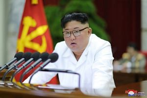 North Korean leader Kim Jong Un speaks during the 5th Plenary Meeting of the 7th Central Committee of the Workers' Party of Korea in this undated photo released on Dec 29, 2019.