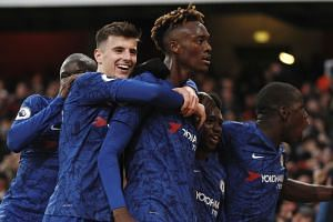Chelsea's Tammy Abraham (right) celebrates with team mates after scoring his side's second goal.
