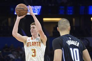 Atlanta Hawks guard Kevin Huerter (left) goes up to shoot in front of Orlando Magic guard Evan Fournier in Orlando Dec 30, 2019.