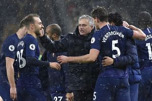Mourinho (centre) celebrates with his players at the end of a match against Wolverhampton Wanderers.