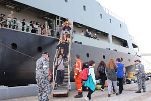 Evacuees disembarking the Australian Royal Navy's MV Sycamore at Bluescope Wharf in Victoria state, as part of bush fire relief efforts, on Jan 4, 2020.